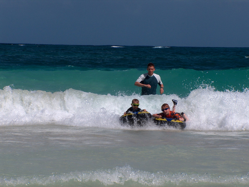 we enjoyed watching 2 young couples having fun in the surf with their kids