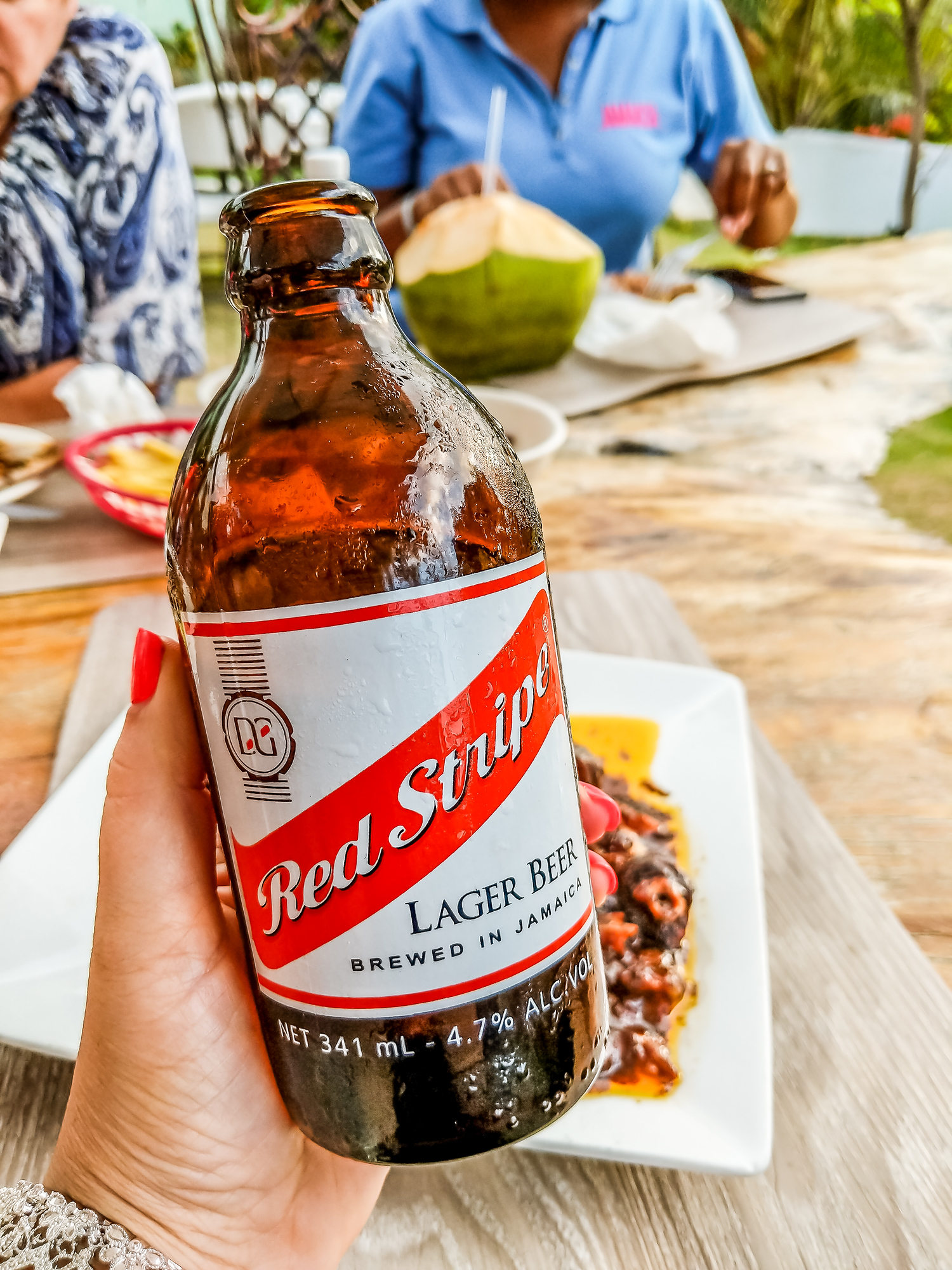 Red Stripe beer is just one traditional Jamaican food you need to try. The ultimate guide for what to eat in Jamaica, our best picks for 27 dishes, 6 desserts and 12 drinks you won't want to leave the island without trying.