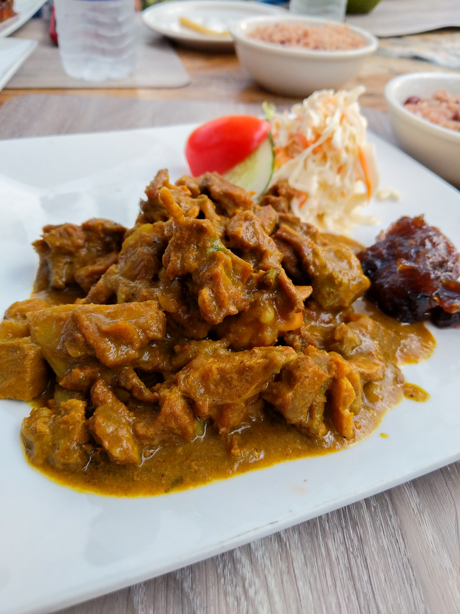 Curry mutton is just one traditional Jamaican food you need to try. The ultimate guide for what to eat in Jamaica, our best picks for 27 dishes, 6 desserts and 12 drinks you won't want to leave the island without trying.