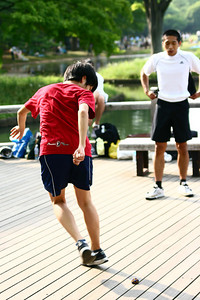 A Japanese version of 'hacky sack' using only your feet and a mini-bean bag replica of a soccer ball... About five people play at a time... Competing against each other, the object of the exercise is to keep the 'ball' afloat for as long as possible whilst pulling dummy and trick manuvers... At the end, they vote for the winner... Then the next group starts...