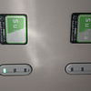 The green/white 'stickers' are card readers: green means you've paid the 'First Class' supplement, red means you haven't... Making life easier for train conducters...