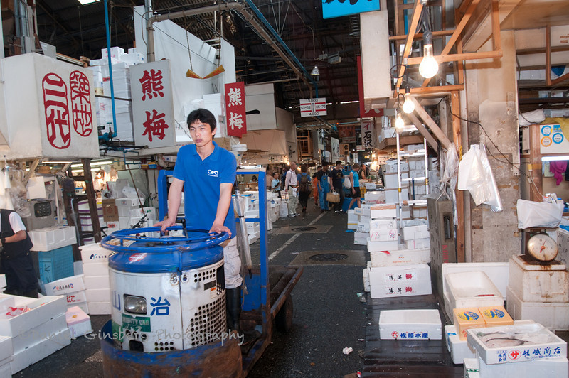 A man drives an electric cart in the Tsukiji Fish Market in Tokyo, Japan.