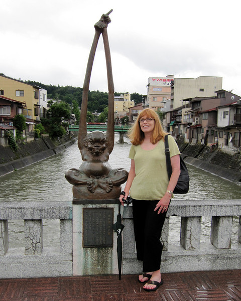 Kaji-Bashi bridge, famous for its Te-naga Ashi-naga  or 'long-arm long-feet' bronze sculptures adorning the bridge.