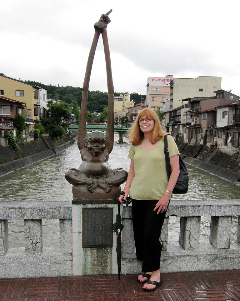Kaji-Bashi bridge, famous for its Te-naga Ashi-naga  or 'long-arm long-feet' bronze sculptures adorning the bridge.