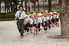 School children line up touring the Hiroshima Peace Memorial Park.