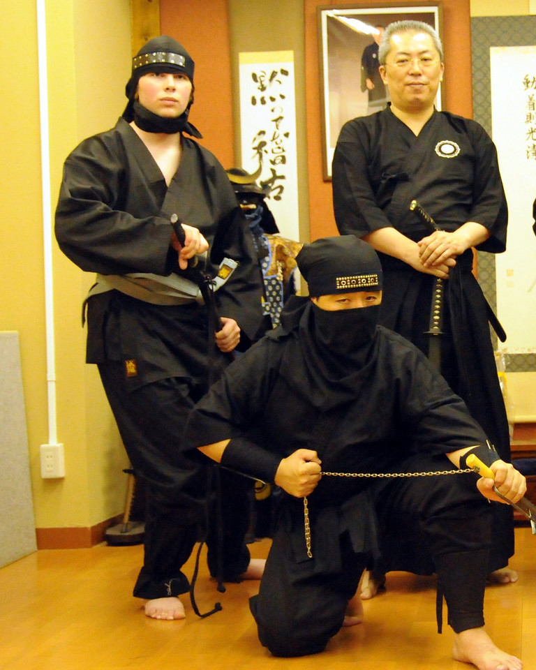 Ninja training lesson in Tokyo. Mike with a Ninja master and a Samuria master.