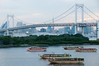 Boats in front of the Rainbow Bridge, as seen from Odaiba, Japan.