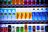 Bright and colorfully displayed drinks in a vending machine at a train station in Hamamatsu, Japan.