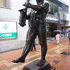 Day 4: Himeji - so what's a pair of wet, weary travelers to do when they've had the rug pulled out from under them? Find food, of course! It was lunch time, so we started looking around for a place to eat. As we wandered, we came across this statue of a naked saxophone player (yes, he really is....look closely). Your guess is as good as ours.