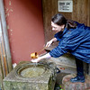 Jeane cleansing her hands prior to tea ceremony, Gyokusen Garden
