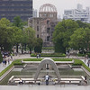 Day 4: Hiroshima - many of the main memorials in the Peace Park were built along an axis. Here we're standing in the Museum, and you can look straight out and see the Cenotaph, the Peace Flame (the wings protruding behind the Cenotaph, which contains a flame which will burn until the world is rid of nuclear weapons), and finally across the river to the Dome. The single visitor, head bowed, standing in line with the whole thing seemed to be very poignant.
