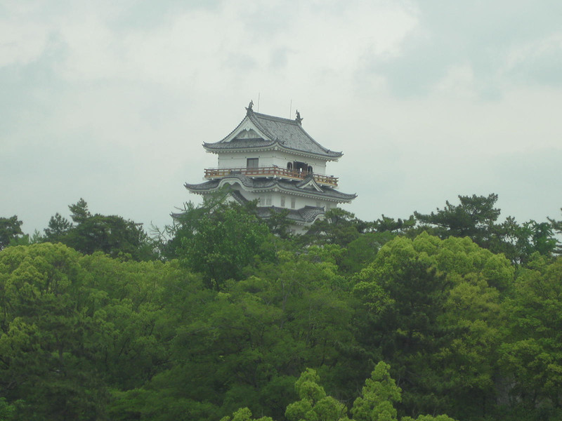 "Day 4: Fukuyama - this is Fukuyama Castle, in the city of Fukuyama, not far from Hiroshima. In my mind, this is how all Japanese castles are meant to look, with the white brick and the curvy roofs and the stepped-back tower. Maybe it's because I'm old enough to remember the miniseries ""Shogun"". However, even though this castle is extremely close to Fukuyama train station, it's just a baby. The castle was destroyed in World War II and was rebuilt in 1966. So this shot is just taken from the train. We chose to go further to see an original."