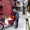Postman near Kikunoya, Kanazawa Japan