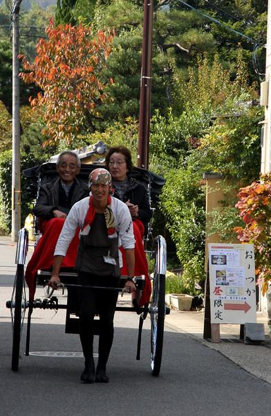 Rickshaw driver and passengers, Arashiyama, Kyoto