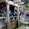 Drinking from sacred waterfall, Kiyomizu-Dera, Kyoto