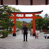 Day 3: Kyoto - here's Brian standing at the entrance to Fushimi-Inari temple. Fushimi is the neighborhood in Kyoto where it's located, and Inari is the name of the god of (among other things) rice. Just behind Brian is the gate. You've probably seen gates like this in all kinds of pictures of Japan, because they're so common they're almost a symbol of the nation. But you've never seen gates like the ones at Fushimi-Inari.......