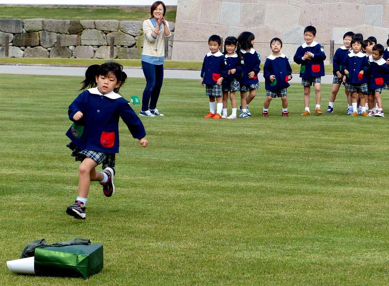 Playing a game outside Kanazawa Castle