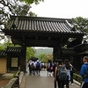 Day 5: Kyoto - passing through the gate of our next stop, Kinkaku-ji, aka the Golden Pavilion. Notice the two Westerners carrying backpacks on the right. These are Andrew and his sister Rachel, from Ventura, CA. Andrew just graduated from Cal State Northridge, and they were spending 8 days in Kyoto to celebrate. They were going the ultra-low-budget route; staying in a youth hostel, buying all their meals from the grocery store, and carefully planning their every move to maximize their yen.