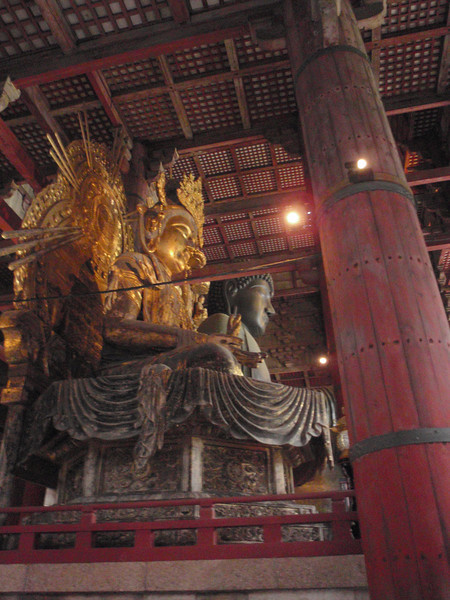 Day 3: Nara - Buddha is flanked on either side by smaller statues of gold.