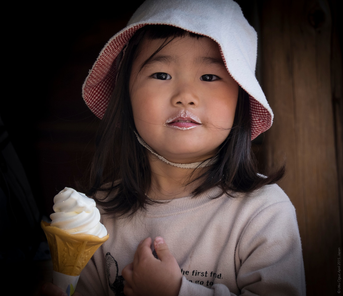 She is sweeter than the ice cream she is eating...