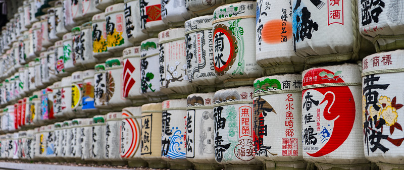 A bunch of cool and colorful sake barrels stacked
