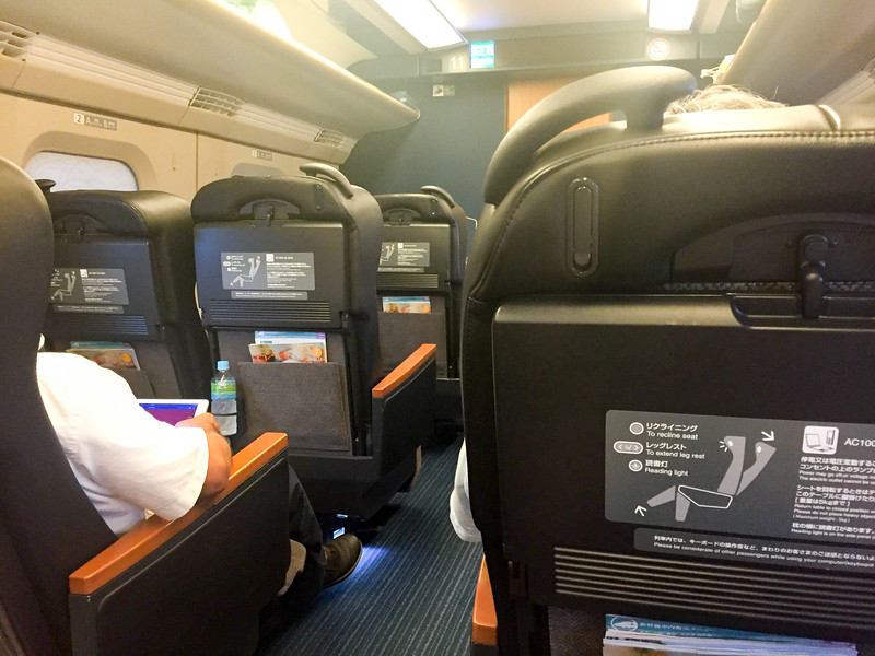 "This is what first class looks like in a bullet train.  They are called ""Green Cars"".  Not bad at all!"