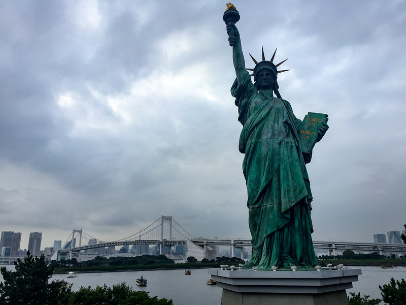 The Statue of Liberty in front of the Rainbow Bridge.  Beautfiul waterfront scene in Tokyo