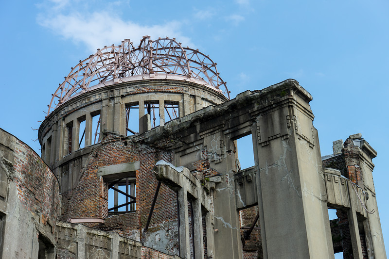 """A-Bomb Dome"" - this building is a famous symbol of Hiroshima.  Formerly the Hiroshima Prefectural Industrial Promotion Hall, it stood about 150m from the hypocenter of the atomic blast.  It stands as it did after that date as a visible and dramatic reminder of the power of the bomb."
