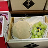 About US$70 for a cantaloupe and some grapes.  Gift grade fruit - the value is in the price.