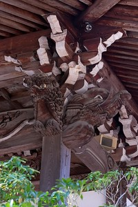 Ornate animal figure on the roof structure.