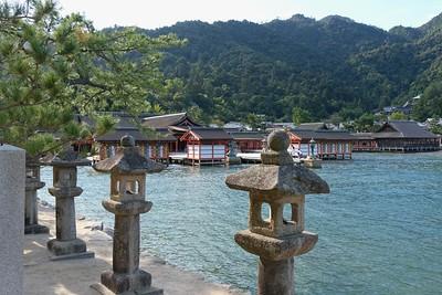 Many stone lanterns line the walk to the Shrine.