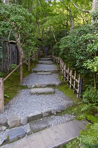 Walk along a serene path to the garden.