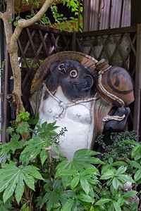 Tanuki statue (Bake-danuki) represent prosperity and economic growth when placed outside a shop. Can also represent virtue, trust, strength and tranquility...