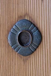Ornate bronze door pull.