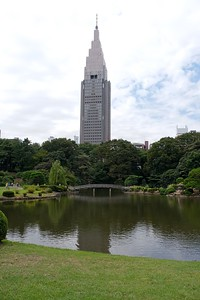 The  NTT Docomo Yoyogi Building looms tall over the gardens.