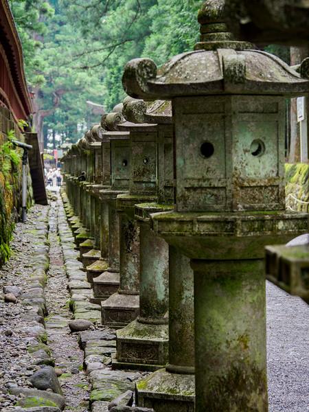 Traditional Japanese stone lanterns at Futarasan Jinja