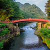 "Vermilion laquered Shinkyo, ""The Sacred Bridge,"" located in Nikko, was built in 1636   and crosses the Daiya River."