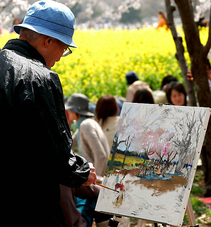 Painter depicting Cherry Blossoms in Park