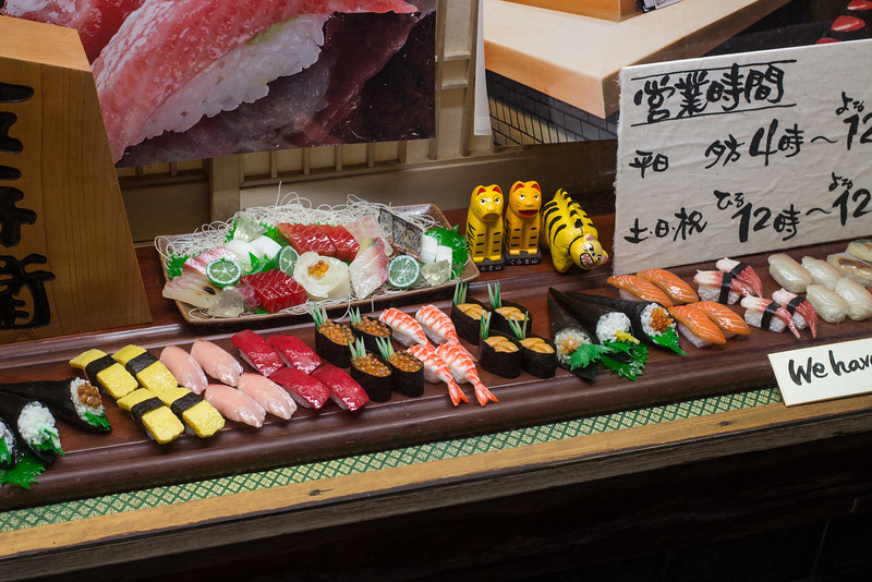 Plastic food in the window. Ponto-cho, a row of traditional restaurants by the river.