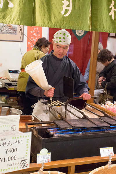 Nishiki Market, the foodie street in Kyoto. These were biscuits with nuts and beans in being made.