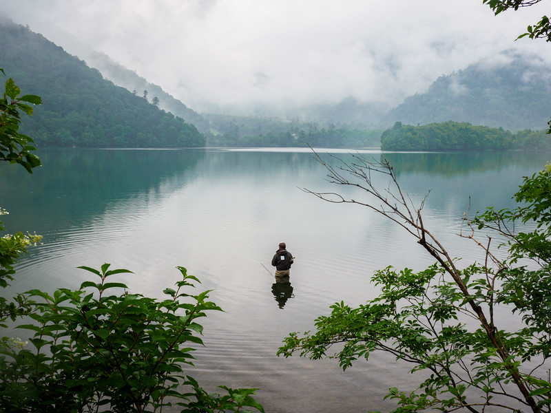 Fly fisherman on Lake Yumoko