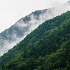 Clouds sitting in ridge between two mountains in Gunma