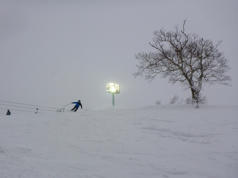 As the afternoon light fades, the lights come on for night skiing