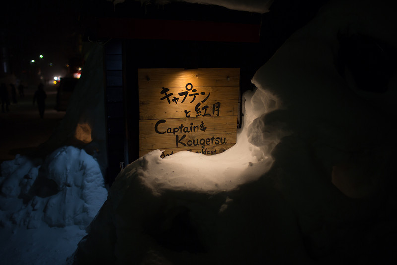 Restaurant signs burried in snow