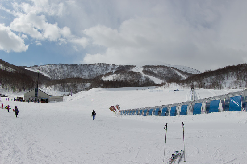 Hanazono base area, magic carpet inside the tunnel, chair lift inside the building on the left