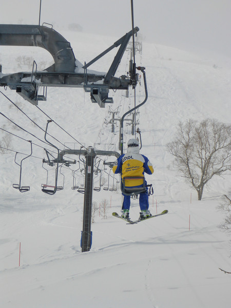 """One seater chairlift, also known as the """"pizza box"""" because that's about the size of the seat. No safety bar, hold on tight."""