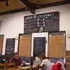 Raku Izakaya. The little orange guy on the blackboard is the potato mascot of the town
