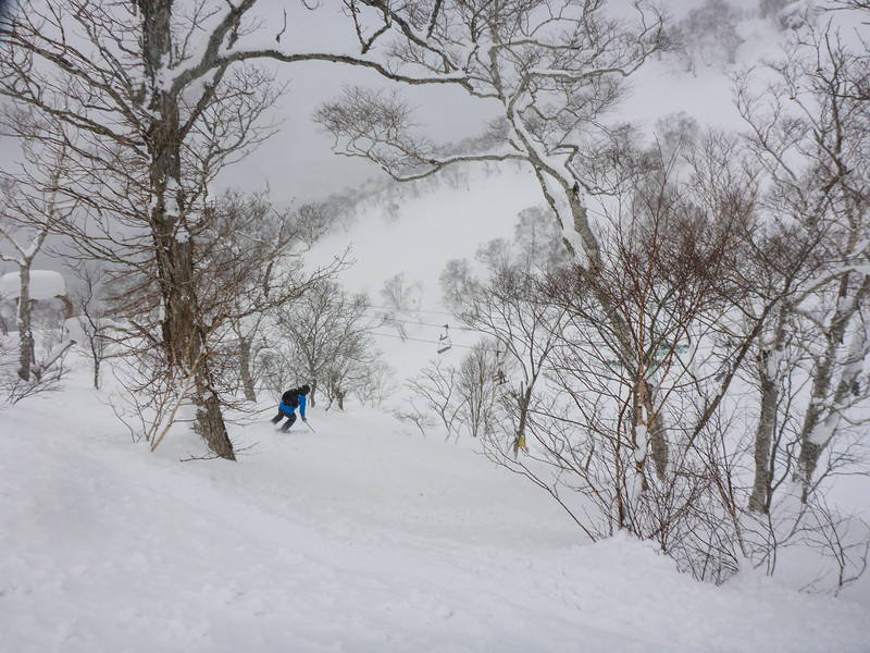 James off into fresh lines through the trees