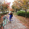 "We rented bicycles for a total cost of $10 per bike per day. Money well-spent. Here are some autumn colors along the Kamo.  My bike is the ""Melon"" colored one while hers is the ""Teka-teka"" (???). It looks lavender to me."