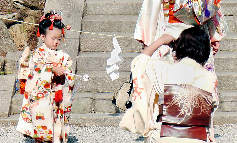 """Japan OAT Trip, Nov 2014.  Nara.  Shichi-Go-San (""""Seven-Five-Three"""") is a traditional rite of passage and festival day in Japan for 3 and 7 year-old girls and 3 and 5 year-old boys.  I believe it was officially on 15 Nov 2014 but they may be out celebrating today also.  Today is (I believe) Labour Thanksgiving Day (Kinro Kansha No Hi),  a day to respect and praise labor and give thanks to each other.<br /> Kasuga Taisha is Nara's most celebrated shrine. It was established at the same time as the capital and is dedicated to the deity responsible for the protection of the city. Kasuga Taisha was also the tutelary shrine of the Fujiwara, Japan's most powerful family clan during most of the Nara and Heian Periods. Like the Ise Shrines, Kasuga Taisha had been periodically rebuilt every 20 years for many centuries. In the case of Kasuga Taisha, however, the custom was discontinued at the end of the Edo Period."""